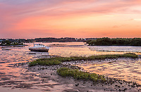 Abandoned shipwrecked boat at sunset in Cedar Key, FL