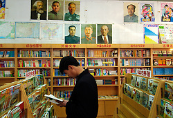 Bookshop in Beijing China with political posters on wall