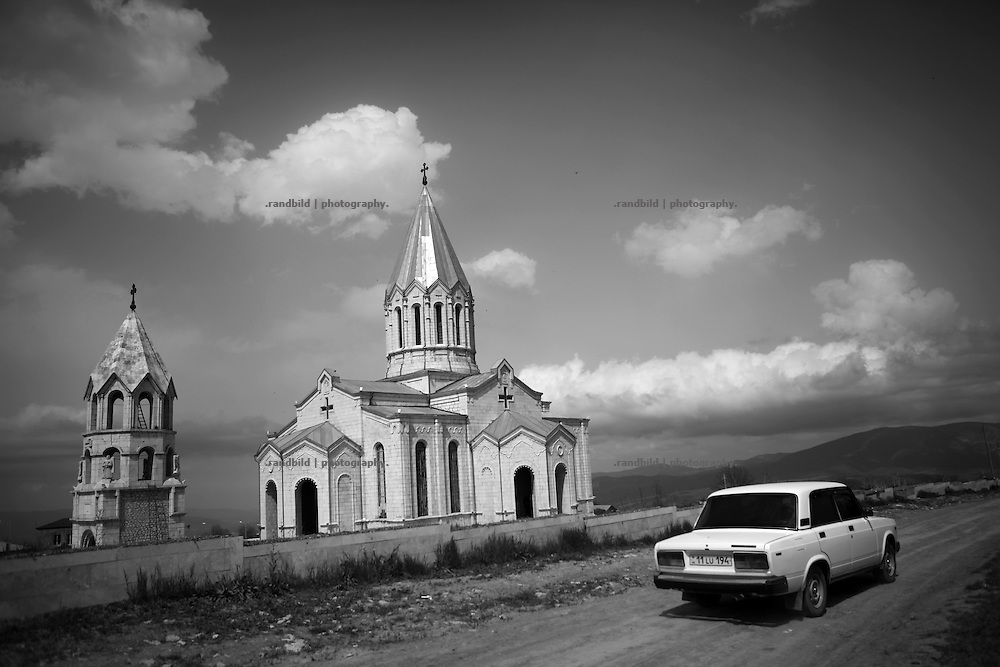 "Ghazanchetsots cathedral. This image is part of the photoproject ""The Twentieth Spring"", a portrait of caucasian town Shushi 20 years after its so called ""Liberation"" by armenian fighters. In its more than two centuries old history Shushi was ruled by different powers like armeniens, persians, russian or aseris. In 1991 a fierce battle for Karabakhs independence from Azerbaijan began. During the breakdown of Sowjet Union armenians didn´t want to stay within the Republic of Azerbaijan anymore. 1992 armenians manage to takeover ""ancient armenian Shushi"" and pushed out remained aseris forces which had operate a rocket base there. Since then Shushi became an ""armenian town"" again. Today, 20 yeras after statement of Karabakhs independence Shushi tries to find it´s opportunities for it´s future. The less populated town is still affected by devastation and ruins by it´s violent history. Life is mostly a daily struggle for the inhabitants to get expenses covered, caused by a lack of jobs and almost no perspective for a sustainable economic development. Shushi depends on donations by diaspora armenians. On the other hand those donations have made it possible to rebuild a cultural centre, recover new asphalt roads and other infrastructure. 20 years after Shushis fall into armenian hands Babies get born and people won´t never be under aseris rule again. The bloody early 1990´s civil war has moved into the trenches of the frontline 20 kilometer away from Shushi where it stuck since 1994. The karabakh conflict is still not solved and could turn to an open war every day. Nonetheless life goes on on the south caucasian rocky tip above mountainious region of Karabakh where Shushi enthrones ever since centuries."