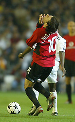 MADRID, SPAIN - Tuesday, April 8, 2003: Manchester United's Ruud Van Nistelrooy falls to the floor after pretending to be elbowed by Real Madrid's Claude Makelele during the UEFA Champions League Quarter Final 1st Leg match at the Estadio Santiago Bernabeu. (Pic by David Rawcliffe/Propaganda)