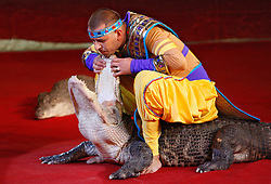 September 15, 2016 - Kiev, Ukraine - An Ukrainian National Circus artist performs with a crocodile during the presentation of the new show program  ''Extreme Arena'' at the Ukrainian National Circus in Kiev, Ukraine, 15 September,2016. The show will be staged from 15 September to 11 December 2016. (Credit Image: © Str/NurPhoto via ZUMA Press)