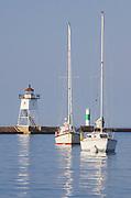 Grand Marais Lighthouse and sailboats moored in Grand Marais Harbor.  North Shore of Lake Superior. Grand Marais, Minnesota