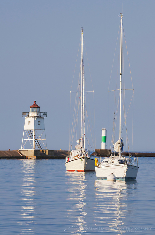 Grand Marais Lighthouse and sailboats moored in Grand Marais Harbor.  North Shore of Lake Superior. Grand Marais, Minnesota