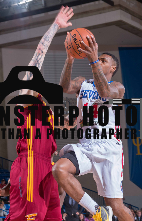 Delaware 87ers Guard SEAN KILPATRICK (14) drives towards the basket in the first half of a NBA D-league regular season basketball game between the Delaware 87ers (76ers) and the Canton Charge (Cleveland Cavaliers) Tuesday, Nov. 17, 2015, at The Bob Carpenter Sports Convocation Center in Newark, DEL