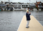 © Licensed to London News Pictures. 28/06/2012. Henley-on-Thames, UK A man takes a photograph. Spectators watch rowing crews compete at the Henley Royal Regatta on June 28, 2012 in Henley-on-Thames, England. The 173-year-old rowing regatta is held 27th June- 1st July 2012. Photo credit : Stephen Simpson/LNP