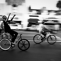A group of bike riders make their way down Hollywood Boulevard.