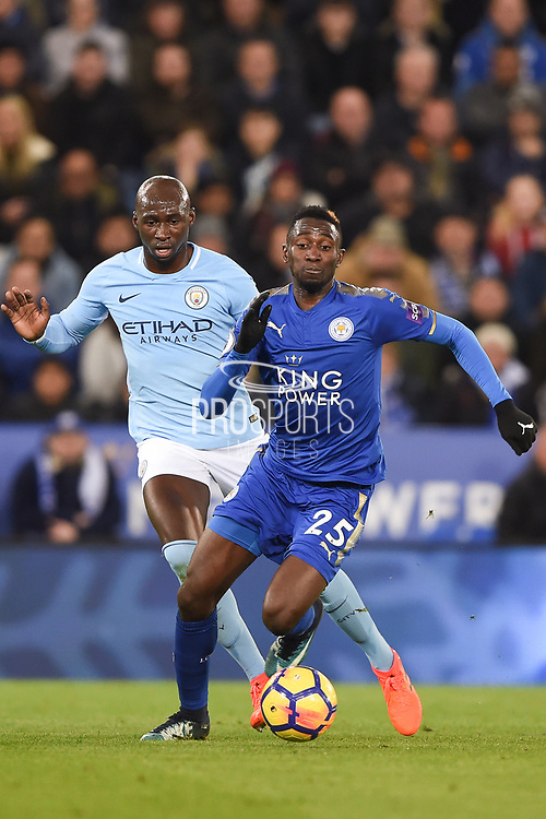 Leicester City midfielder Wilfred Ndidi (25) battles with Manchester City defender Eliaquim Mangala (15) during the Premier League match between Leicester City and Manchester City at the King Power Stadium, Leicester, England on 18 November 2017. Photo by Jon Hobley.