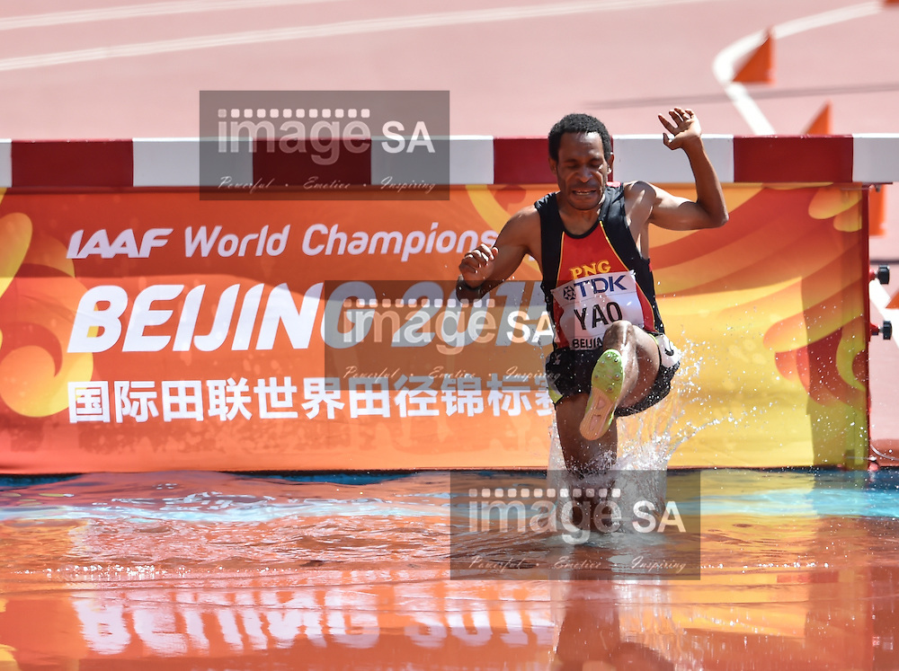BEIJING, CHINA - AUGUST 22: Sapolai Yao of Papua New Guinea (PNG) at the water jump in the mens 3000m steeplechase during day 1 of the 2015 IAAF World Championships at National Stadium on August 22, 2015 in Beijing, China. (Photo by Roger Sedres/Gallo Images)