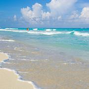 Couple at the beach. Cancun, Quintana Roo. Mexico.