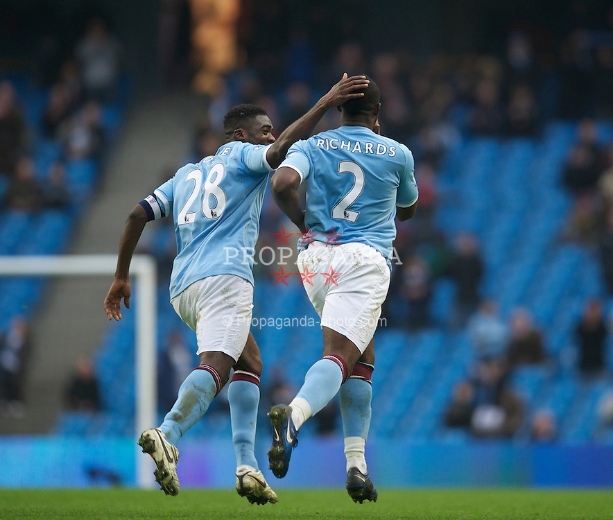 MANCHESTER, ENGLAND - Sunday, February 20, 2011: Manchester City's Micah Richards celebrates scoring the fifth goal against Notts County during the FA Cup 4th Round Replay match at the City of Manchester Stadium. (Photo by David Rawcliffe/Propaganda)