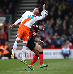 Blackpool's Gary Madine leaps above Bournemouth's Steve Cook - Photo mandatory by-line: Robbie Stephenson/JMP - Mobile: 07966 386802 - 14/03/2015 - SPORT - Football - Bournemouth - Dean Court - AFC Bournemouth v Blackpool - Sky Bet Championship