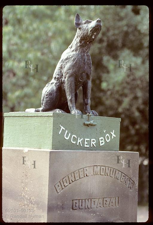 Statue poses legendary dog on top of 'tucker box' (lunch kit) at roadside park near Gundagai, NSW Australia