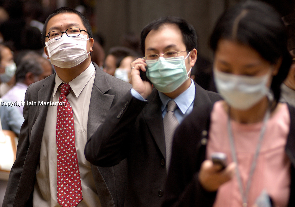 Office workers in Hong Kong wearing face masks during SARS disease outbreak in 2003