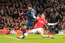 19.02.2014, Emirates Stadion, London, ENG, UEFA CL, FC Arsenal vs FC Bayern Muenchen, Achtelfinale, im Bild Laurent Koscielny (Arsenal FC #6) im Zweikampf gegen / tackling against Claudio Pizarro (FC Bayern Muenchen #14), Aktion, Action // during the UEFA Champions League Round of 16 match between FC Arsenal and FC Bayern Munich at the Emirates Stadion in London, Great Britain on 2014/02/19. EXPA Pictures © 2014, PhotoCredit: EXPA/ Eibner-Pressefoto/ Schueler<br /> <br /> *****ATTENTION - OUT of GER*****