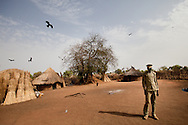 James Kumen a young district administrator stands in the compound where he sleeps near Boma in Jonglei state on March 12, 2010. Armed only with a creditless satellite phone and a university educaction he is responsible for administering dozens of remote hamlets and villages.