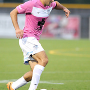 Wilmington's Steven Miller dribbles against Dayton Saturday August 9, 2014 at Legion Stadium in Wilmington, N.C. (Jason A. Frizzelle)