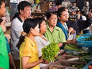 31 DECEMBER 2015 - BANGKOK, THAILAND: People shop for fresh produce in Bang Chak Market. The market is supposed to close permanently on Dec 31, 2015. The Bang Chak Market serves the community around Sois 91-97 on Sukhumvit Road in the Bangkok suburbs. About half of the market has been torn down. Bangkok city authorities put up notices in late November that the market would be closed by January 1, 2016 and redevelopment would start shortly after that. Market vendors said condominiums are being built on the land.          PHOTO BY JACK KURTZ