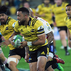 Matt Proctor makes a break during the Super Rugby match between the Hurricanes and Lions at Westpac Stadium in Wellington, New Zealand on Saturday, 5 May 2018. Photo: Dave Lintott / lintottphoto.co.nz