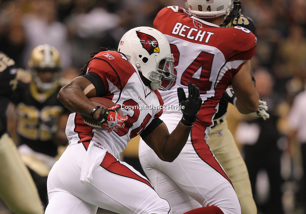 16 January 2010:  Arizona Cardinals running back Tim Hightower (34) during a 70-yard touchdown run in the first quarter of a 45-14 win by the New Orleans Saints over the Arizona Cardinals in a 2010 NFC Divisional Playoff game at the Louisiana Superdome in New Orleans, Louisiana.
