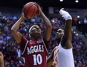 SAN DIEGO, CA - MARCH 16:  Jemerrio Jones #10 of the New Mexico State Aggies shoots against Elijah Thomas #14 of the Clemson Tigers during a first round game of the Men's NCAA Basketball Tournament at Viejas Arena in San Diego, California. Clemson won 79-68.  (Photo by Sam Wasson)