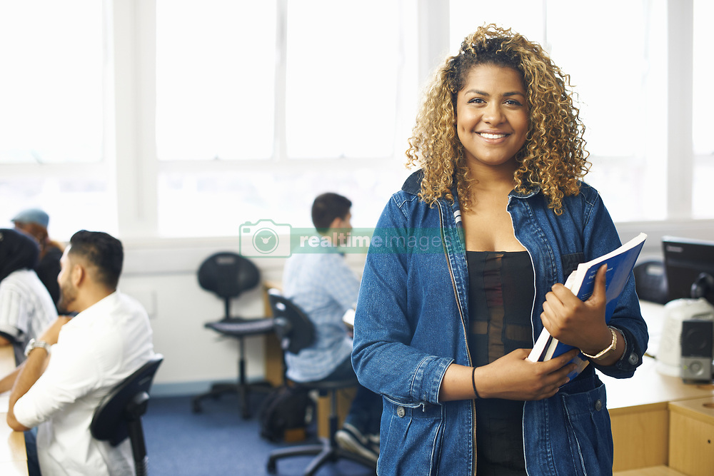 June 25, 2014 - Portrait of teenage female student with file in college classroom (Credit Image: © Image Source/Image Source/ZUMAPRESS.com)