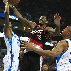 02 February 2009: Portland Trailblazers center Greg Oden (52) grabs a rebound between Hornets defenders Rasual Butler (45) and David West (30) during a 97-89 loss by the New Orleans Hornets to the Portland Trail Blazers at the New Orleans Arena in New Orleans, LA.