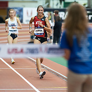 February 15, 2014 - New York, NY : Rachel Seaman of the New York Athletic Club, foreground in red, competes in the Women's USATF Championship Mile Walk (Elite) during the 2014 NYRR Millrose Games at the The New Balance Track & Field Center at The Armory in Washington Heights, Manhattan, on Saturday afternoon. Seaman won the race. CREDIT: Karsten Moran for The New York Times