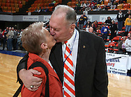 Waukon Coach Gene Klinge kisses his wife Pat after their win over MFL MarMac 48-38 for his 939th career victory during their Rivalry Saturday game at the US Cellular Center in Cedar Rapids on Saturday January 2, 2010. (Stephen Mally/Freelance)