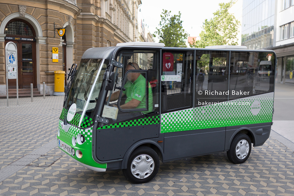 "A zero emission electric Kavalier vehicle on Slovenska Cesta (street) in the Slovenian capital, Ljubljana, on 25th June 2018, in Ljubljana, Slovenia. The ""Kavalier"", is an environmentally friendly concept of free city transport in Ljubljana which drive in the pedestrian zone of the old town center are mainly intended for older citizens, people with reduced mobility and tourists. Because of the low speed you can stop and board a ""cavalier"" while driving, but you can also order it by phone."