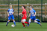 Cardiff's Sammy Hallsworth advances the ball during the FA Women's Premier League match between Brighton Ladies and Cardiff City Ladies at Brighton's Training Ground, Lancing, United Kingdom on 22 March 2015. Photo by Geoff Penn.