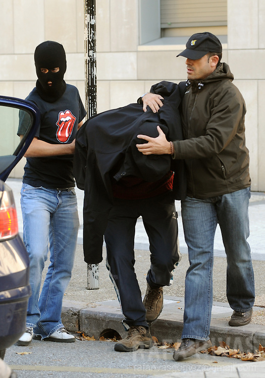 An unidentified suspect of being a member of pro-independence young Basque association SEGI  is taken into a Police-car after his arrest, on November 24, 2009, in the northern Spanish Basque city of San Sebastian. 36 people were arrested by Spanish National Police during an anti-terrorist operation, in the Basque Country and Navarra, ordered by Spanish judge Grande Marlaska. PHOTO/Rafa Rivas