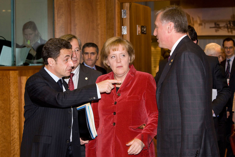BRUSSELS - BELGIUM - 11 DECEMBER 2008 -- EU Summit under the French Presidency -- The French Precident Nicolas SARKOZY arrives with with Angela MERKEL,  Federal Chancellor of Germany and Mirek TOPOLANEK, Czech Prime Minister. Photo: Erik Luntang