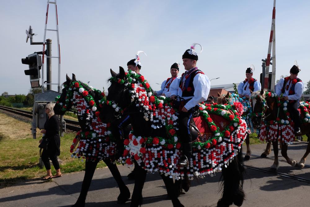 Riders in Kunovice, Czech Republic, crossing railroad tracks, at the Jizda Kralu, Ride of the Kings.