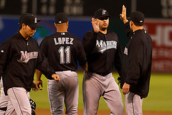 June 29, 2011; Oakland, CA, USA;  Florida Marlins starting pitcher Ricky Nolasco (center) celebrates with teammates after the game against the Oakland Athletics at the O.co Coliseum.  Florida defeated Oakland 3-0.