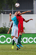 Slovenia defender Gasper Cerne (5) and Portugal defender Gabriel Costa (4) go up for a header during a CONCACAF boys under-15 championship soccer game, Sunday, August 11, 2019, in Bradenton, Fla. Portugal defeated Slovenia in the final in 2-0. (Kim Hukari/Image of Sport)