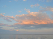 Clouds and buoy at sunset
