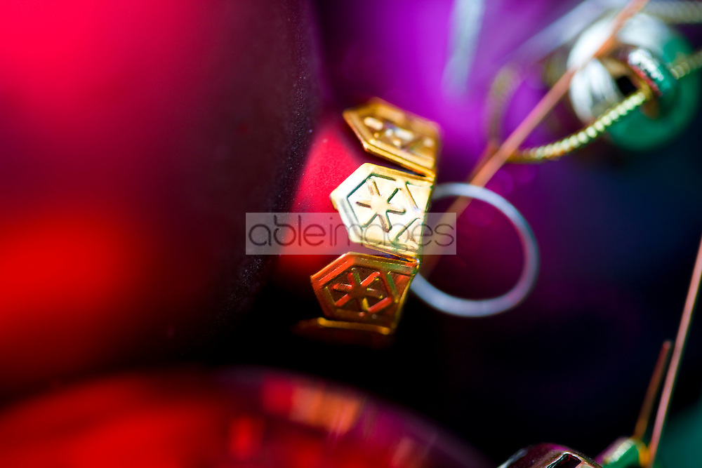 Extreme close up of red and purple Christmas baubles