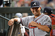 Jul 24, 2017; Phoenix, AZ, USA; Atlanta Braves catcher Kurt Suzuki (24) smiles in the dugout in the MLB game against the Arizona Diamondbacks at Chase Field. Mandatory Credit: Jennifer Stewart-USA TODAY Sports