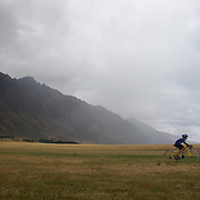 A junior competitor in action in the cycle leg of the junior triathlon during the Active Q T Ultimate Tri Series Jack's Point Triathlon, Jack's Point,  Queenstown, Otago, New Zealand. 14th January 2012. Photo Tim Clayton