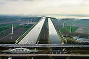 Nederland, Zeeland, Gemeente Reimerswaal, 01-04-2016; Schelde-Rijnverbinding, richting Antwerpen met kerncentrale Doel aan de verre horizon. Rechts Bathse spuikanaal gezien naar de Westerschelde. Spuikanaal en spuisluis zorgen mede voor de zoetwaterhuishouding van het Zoommeer en maken onderdeel uit van de Deltawerken.<br /> Canal to Antwerp and and drainage canal, part of the fresh water management works, build as part of the Delta Works.<br /> <br /> luchtfoto (toeslag op standard tarieven);<br /> aerial photo (additional fee required);<br /> copyright foto/photo Siebe Swart
