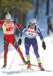Emil Hegle Svendsen of Norway and Klemen Bauer of SLovenia during the Men 20 km Individual of the e.on IBU Biathlon World Cup on Thursday, December 16, 2010 in Pokljuka, Slovenia. The fourth e.on IBU World Cup stage is taking place in Rudno Polje - Pokljuka, Slovenia until Sunday December 19, 2010.  (Photo By Vid Ponikvar / Sportida.com)