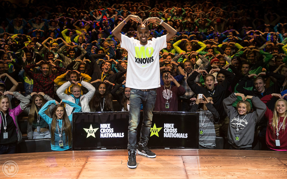 "Nike elite athlete, Mo Farrah,  joined attendees at the NXN 2013 awards ceremony for a ""Mobot"" moment on December 7, 2013 at the Stanford Theater at the Tiger Woods Center at Nike World Headquarters in Beaverton, OR.  (Image © Ross Dettman)"