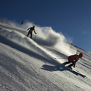 Kelly Gallagher, Great Britain, (left) with guide Charlotte Evans in action during the Women Giant Slalom Visually Impaired competition at Coronet Peak, during the Winter Games. Queenstown, New Zealand, 23rd August 2011. Photo Tim Clayton.