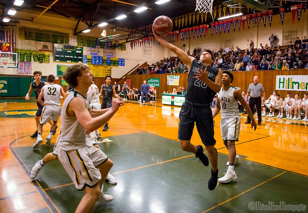 Liberty Ranch Hawks Gabriel Nino (20), shoots the ball during the first quarter as the Placer Hillman host the Liberty Ranch Hawks Varsity basketball team in the DIV NorCal boys quarterfinal, Saturday Mar 10, 2018.  <br /> photo by Brian Baer