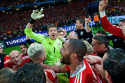 +++ MINIMUM USE FEE £250 or A TOURNAMENT PASS FOR £3000+++<br /> LILLE, FRANCE - Friday, July 1, 2016: Wales' goalkeeper Wayne Hennessey celebrates a 3-1 victory over Belgium and reaching the Semi-Final during the UEFA Euro 2016 Championship Quarter-Final match at the Stade Pierre Mauroy. (Pic by David Rawcliffe/Propaganda)