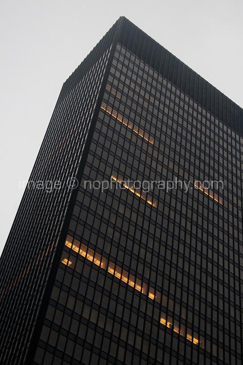 Midtown Manhattan skyscraper building in the evening time  New York