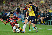 21.04.2013 Sydney, Australia. Wanderers defender Nikolai Topor-Stanley and Mariners Daniel McBreen in action during the Hyundai A League grand final game between Western Sydney Wanderers FC and Central Coast Mariners FC from the Allianz Stadium.Central Coast Mariners won 2-0.