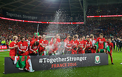 CARDIFF, WALES - Tuesday, October 13, 2015: Wales players celebrate qualifying for the finals after a 2-0 victory over Andorra during the final UEFA Euro 2016 qualifying Group B match at the Cardiff City Stadium. Joe Allen, Gareth Bale, Aaron Ramsey. (Pic by Barry Coombs/Propaganda)