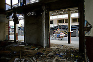 2016/08/04 – Portoviejo, Ecuador: Two scavengers cycle around Portoviejo, Ecuador, looking for things among the collapse buildings in the centre of the city, 4th August 2016. Portoviejo's centre due to its old buildings was heavily damaged by the earthquake of 16th April. (Eduardo Leal)