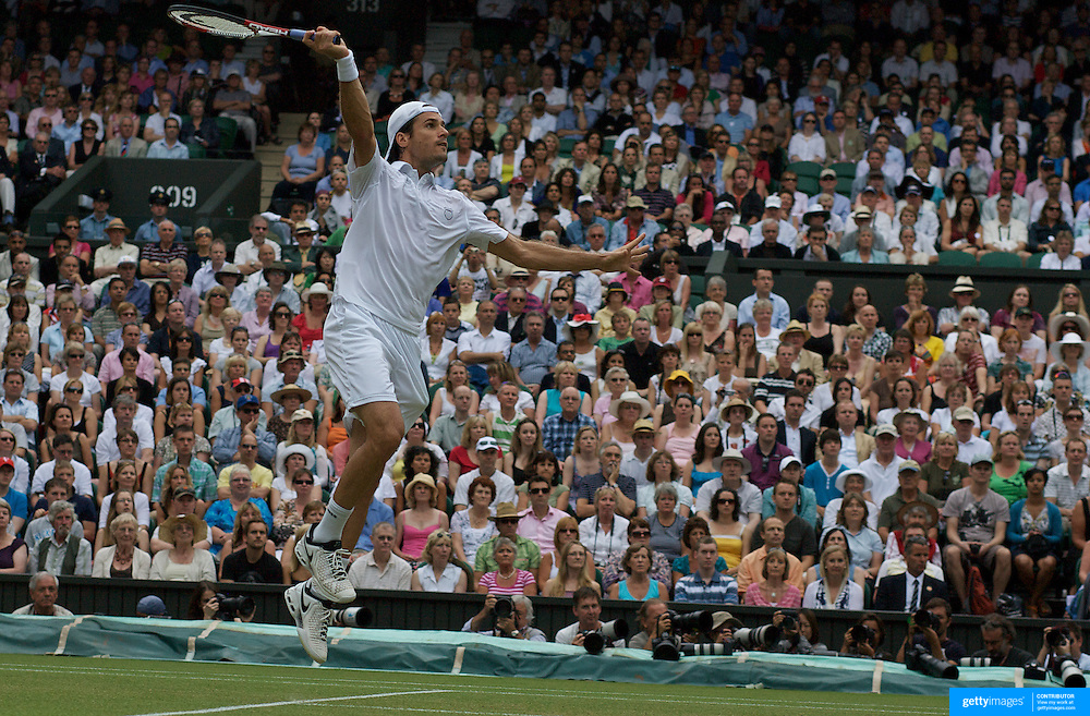 Tommy Hass, Germany, in action against Roger Federer, Switzerland, during the Men's Singles Semi Final Match at the All England Lawn Tennis Championships at Wimbledon, London, England on Friday, July 03, 2009. Photo Tim Clayton.